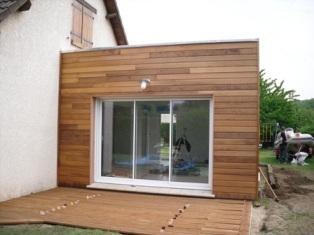 Agrandissement avec toit terrasse fabriqué en bois