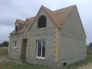 Maison individuelle en construction for Artisan constructeur maison individuelle