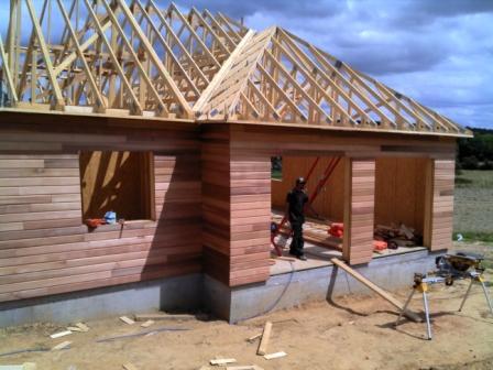 Pose du bardage et charpente sur maison bois for Album photo construction maison