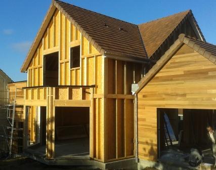 Construction dans les yvelines d 39 une maison en ossature bois for Reglementation construction garage