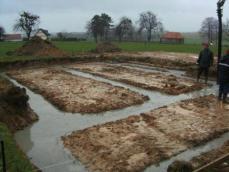 Coulage des fondations maison en bois