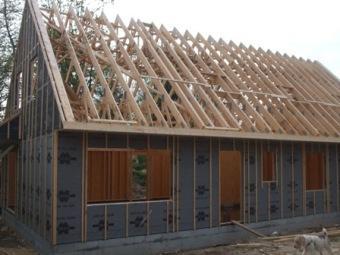 Fourniture pose d 39 une ossature bois construite en hors d 39 eau for Pare pluie bardage bois