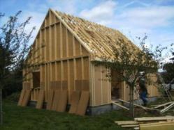 Pose isolation maison bois