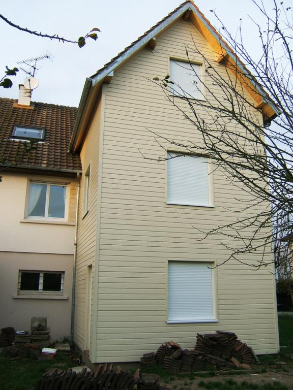 Extension construite en bois sur trois niveaux