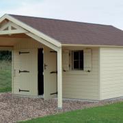 Garage bois avec avancée fabriqué en ossature bois