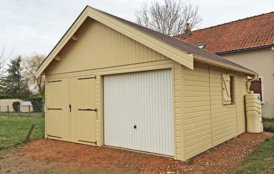 Garage en ossature bois avec bardage de couleur for Garage en bois a toit plat