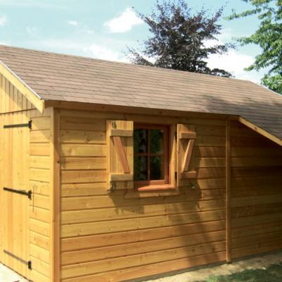 Garage fabriqué en ossature bois et bardage naturel