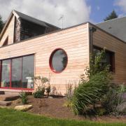 Maison agrandie avec une extension construit en ossature bois