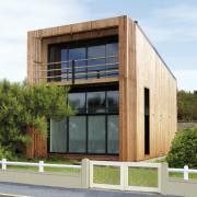 Maison ossature bois toit plat moderne