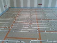 Artisans électricien plancher chauffant maison ossature bois
