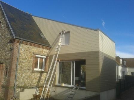 Agrandissement de maison en bois avec bardage de couleurs for Agrandissement maison garage