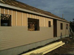 maison construite en ossature bois avec bardage de couleur. Black Bedroom Furniture Sets. Home Design Ideas