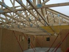 Construction maison en ossature bois pose fermettes 1