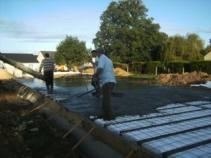 Coulage dalle beton pour construction maison bois 1