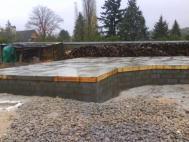 Coulage de la dalle beton pour maison ossature bois