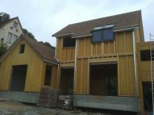 Couverture en tuiles sur maison en bois dans les yvelines