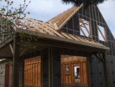 Detail de charpente sur maison en bois