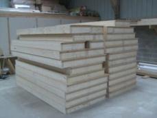 Fabrication murs ossature bois construction maison artisanale