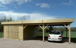 Garage bois, avec toit plat et carport réalisé en ossature bois