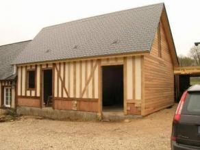 Habillage en colombages d'une maison bois