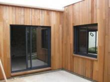 Maison bois construction artisanale en ossature bois