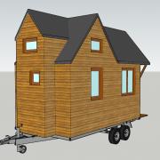 Photo d'une maisonnette en bois sur roues transportable