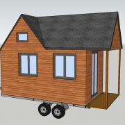 Mini maison en bois construite sur roues dit tiny house