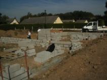 Montage des murs du vide sanitaire maison en bois construite en normandie evreux 1