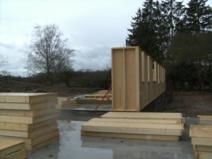 Montage murs ossature bois par charpentiers