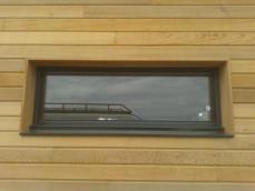 Pose fenêtre sur tiny house en ossature bois